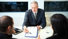 Businessman showing a document (johnpaul96333) Tags: divorce mediator london divorcemediatorlondon
