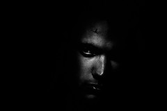 In shadow (Vitor Pina) Tags: scenes contrast candid photography people pretoebranco pessoas portraits portrait pina urbano eyes man homem faces face dark shadows