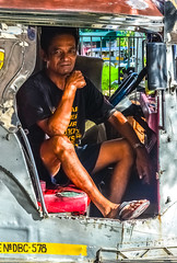 A moment in time.... (tomk630) Tags: manila philippines hot afternoon momentintime jeepney driver break