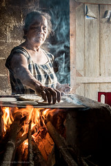 EMP_20121109_086.jpg (Ojo de Piedra) Tags: wood huastecapotosina portrait community nikon smoke cooking tortillas indigenous maz mexico timber flames food faces comal travel hot woman smalltown autumn nikon1 people fire nikkorlens kitchen maz sanluispotosi mex
