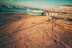 Boats... (hobbit68) Tags: beach sky wolken clouds himmel sommer ozean andalucia boats outdoor küste sonne old strand canon boote port wasser gebäude sonnenschein alt holiday sunset playa espana spanien urlaub ufer river verfallen meer