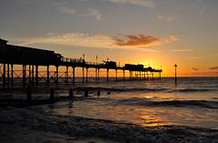 Sunrise by Teignmouth Pier (rosiespoonerphotos) Tags: teignmouth teignmouthpier nikond5000 tamronspaf1024mmf3545diiildasphericalif sunrise beach westcountry waterscape seascape nikonnx gimp rosiespooner rosiespoonerphotography rosyrosie2009 rosemaryspooner rosiesphotos sea seashore swcp southwestcoastpath southdevon southwest