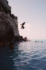 Tropea, Italy (OQ62) Tags: film analog italy italia calabria epsonv700 tropea contax g2 kodak color plus 200 contaxg2 kodakcolorplus200 beach mare diving jumping 35mm