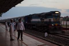 Train passing by (Scalino) Tags: india karnataka travel trip train indiantrain indian railway station badami chai wallah boarding blue coach nehrucap