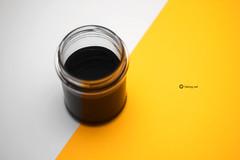 A sunshine ray (fabiog86) Tags: anygivensunday sunshineray stilllife color yellow white black liquid jar canon 50mm canoneos60d focus soft fabiog