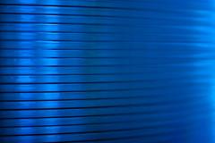 CD stack (lenswrangler) Tags: lenswrangler digikam rawtherapee strobist edge flickrfriday macromondays unusual cd rogue flash bluegel abstract lines texture blue dof depthoffield