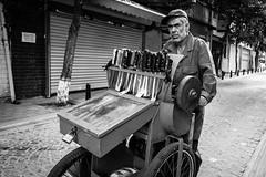 Itinerant Knife Sharpener (Mustafa Selcuk) Tags: streetvendor knife bw bnw blackandwhite streetphotographer monochrome monochromatic balat fener fujifilm istanbul street streetphotography turkey turkiye xpro2
