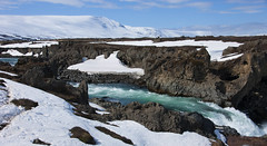 I'm bound where the wild river rolls ... (lunaryuna) Tags: iceland centralnorthiceland landscape godafoss waterfall river skjlfandafljt rivercanyon geologicalformations wildriver spring season seasonalwodners seasonalchange snowcoveredmountain rockformations wintersun lunaryuna panoramicviews