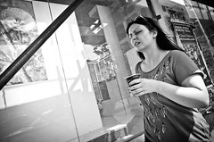 Thank You, Coffee, My Love (stimpsonjake) Tags: nikoncoolpixa 185mm streetphotography bucharest romania city candid blackandwhite bw monochrome coffee woman love