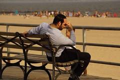 """Worry Worry, worry, worry, worry Worry just will not seem to leave my mind  alone"" - Ray LaMontagne (Lidiya Nela) Tags: streets city sonyalpha summer urban people candid streetphotography peopleurban newyorkcity nyc newyork boardwalk beach coneyisland brooklyn"