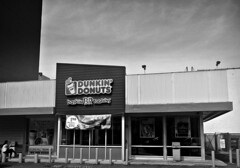 Dunkin' & Baskin (Robert S. Photography) Tags: dunkindonuts baskinrobbins storefront through drivethrough bw monochrome sky clouds street woman phone coffee donuts nyc brooklyn canon powershot elph160 iso100 september 2016