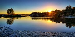 Lindy, Norway (Vest der ute) Tags: g7x norway rogaland ryksund seascape earlymorning sunrise sunstar landscape trees reflections mirror beach fav25 fav200