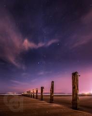 Night between the posts (Ayrshire & Arran Photo (Richard Cottrell)) Tags: seascape night scotland coast groyne ayrshirecoast skies milkyway sky ayrshire longexposure stars nightphotography
