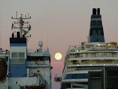 Shipping the moon (KaarinaT) Tags: two moon finland harbor helsinki ship ships fullmoon pinksky siljaeuropa interestingfullmoonshot pinkishmoon moonattheharbor twoshipswithfullmoon fullmoonbetweentwoships