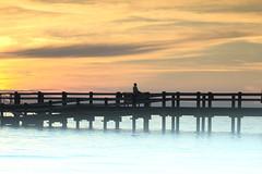 sitting on the dock of the bay (kimblomqvist) Tags: sunset sundown sunlight sun sky clouds cloudscape pier beautiful silhouettes silhouette people person ocean water sea seascape shore shoreline summer warm verano temar mer