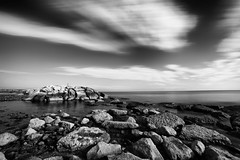 Constant calm (Mario Ottaviani Photography) Tags: constant calm peace sea seascape reefs cliffs moving biancoenero bianco nero black white blackandwhite bw bn monocromo monochrome grey gray paesaggio landscape travel adventure nature scenic exploration view vista breathtaking tranquil tranquility serene serenity freedom marioottaviani italy italia elevatedview naturallandmark gabicce longexposure smooth sony samyang sonyalpha wide wideangle