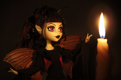Attraction  (Mariko&Susie) Tags: monsterhigh howdoyouboo lunamothews luna booyork moth yellow insect wings butterfly papillonsdenuit polilla indoor candle candlelit flame atmosphere burn dark goth dress begoths bleedingedge toy toys doll dollphotography dolls canoneos600d canoneosrebelt3i canoneoskissx5 50mmlens marikosusie sistersmarikosusie mariko susie