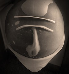 Accidental Visage (Sea Moon) Tags: rubber balloons face creases folds bubbles wet latex macro wrinkles mask