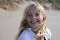 The wildness. (Avian Sky) Tags: girl beach woolacombe devon child smile hair wind autumn