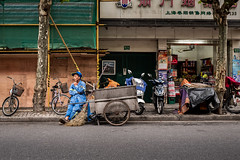 city sweeper (Rob-Shanghai) Tags: sweeper cleaner street resting shanghai china people chinese leica leicaq