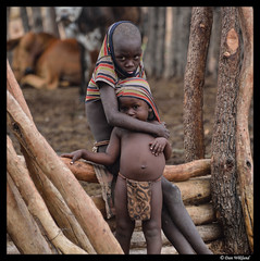 Protection from the rain (Dan Wiklund) Tags: namibia himba boy male african africa man d800 2013