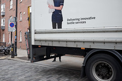 Delivered on foot (Stubwoi) Tags: london uk city street legs advertising van truck standing position man delivery fuji x100s