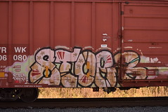 STOER (TheGraffitiHunters) Tags: graffiti graff spray paint street art colorful freight train tracks benching benched stoer boxcar