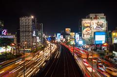 Gone in 2 seconds (Blue Nozomi) Tags: manila traffic commute mrt travel edsa car bus truck track rail billboard ad lights night evening trails lightrails