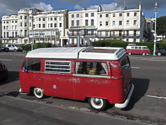 A Pair of Red VW Campers. (ManOfYorkshire) Tags: vw bus camper campers red modernised restored splitscreen 2toine paintwork brighton sussex seafront faded attention needs window folding roofrack volkswagen