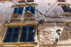 Windows (Timo Sutinen) Tags: old building house wall windows wires lines lamp summer croatia holiday blue flower flowers