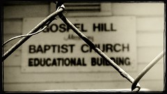 Gospel Hill missionary Baptist Church Educational Building, 1st version (thegoreyend) Tags: blackandwhite bw blur church monochrome fence mono blurry texas blurred eddie fenced houstontexas iphone newsprint agno neighborhoodchurch iphoneapp iphoneography kitcam