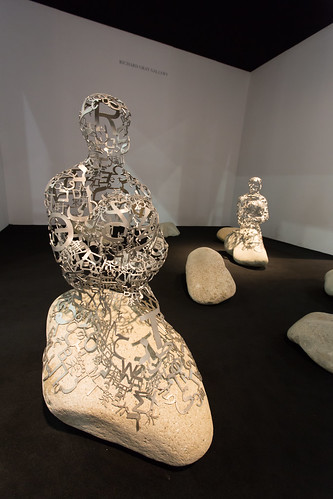 """Installation by Jaume Plensa (b. 1955): Islands, 2012. (stainless steel and stone)"" / Richard Gray Gallery / Art Basel Hong Kong 2013 / SML.20130523.6D.13867"