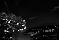Mike Driscoll 2016 - Le Carrousel (B&W) (Michael Driscoll Jr.) Tags: merrygoround carousel lights night lamps around vintage icecream france eiffeltower carnival ride concession stand decorative ornate darkness fun child childlike fair