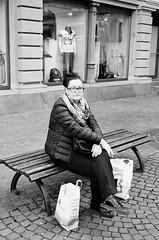 Waiting (Ursus Bear) Tags: canon eos 650 analog ef 3570 f3545 ilford xp2 400 35mm 135 monochrome bw blackwhite black white film monochromatic blackandwhite mono chrome ilfordxp2400super bwfp bwwoman city busy shopping store woman women bag street road place