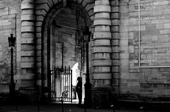 By watching the entrance (pascalcolin1) Tags: paris13 salptrire gardien guard mur wall lamppost lampadaires entre entrance porte door photoderue streetview urbanarte noiretblanc blackandwhite photopascalcolin ombre shadow lumire light pierres backlight