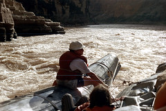 34-596 (ndpa / s. lundeen, archivist) Tags: nick dewolf nickdewolf color photographbynickdewolf 1970s 1973 film 35mm 34 reel34 arizona northernarizona southwesternunitedstates grandcanyon coloradoriver raftingtrip raftingexpedition water river raft inflatable people sanderson sandersonriverexpeditions srig lifejacket lifepreserver floatationdevice scratch scratches scratched whitewater rapids child boy hat 1972 sandersonraftingexpeditions