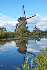 historical dutch windmills (Stan de Haas Photography) Tags: dutch holland touristic landmark field summer water mill rustic netherlands agriculture green river travel view power european culture attraction history turbine environmental scenery ecology polder old picturesque traditional countryside historic energy kinderdijk retro heritage famous reflection wind blue rural sky scenic tourism vintage scene nature environment rotterdam europe windmill landscape standehaas