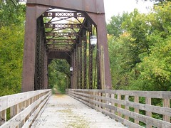 IMG_0363 (Sally Knox Sakshaug) Tags: fall autumn october nature outdoors sky walk walking bridge wood metal steel rail railing line lines plank floor overhead beam light electric trail wooded woods solitude calm secluded quiet enclosed overhung trees leaf strewn pretty