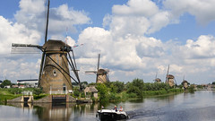 Old and the new (Rebecca Wolff) Tags: 2016 netherlands summer kinderdijk windmill