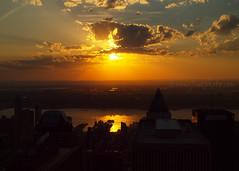 Hudson Sunset (2013) (.annajane) Tags: nyc newyorkcity sunset orange usa cloud newyork reflection water skyline river cityscape rockefellercenter hudsonriver hudson topoftherock