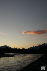 Sunset by the Bow River (ryan.kole32) Tags: canmore canmorealberta banff banffalberta banffnationalpark alberta canada canadianrockies rockymountains rockies landscape nature beauty beautyinnature travel outdoors hiking river valley bowriver bowvalley shore water sunset naturallight bluesky clouds orange sony sonya77