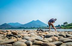 Stone_skimmer (sachasplasher) Tags: skimming stones skim skimmer stone rock water lake river mountain throwe thailand laos pebble pebbles