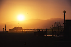 Pier (Aaron J Barber) Tags: orange glow sky beach pier sunset california wheel ferris amusement park themepark stilts silhouette kite shower lamp sea ocean santamonica losangeles la mountains malibu