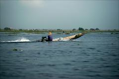Full speed ahead (*Kicki*) Tags: longboat myanmar burma inlelake inle inlaylake inlay lake boat canoe speedboat shanstate man person fisherman water sky transport vehicle blue houses