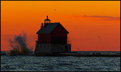 Sunset at Grand Haven, MI (AkshayDeshpande) Tags: sunset light michigan grand haven lighthouse lake waves water usa orange red blue canon t3i 600d birds