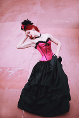 Pink Victorian (Kelly McCarthy Photography) Tags: woman model beautiful beauty fashion style glamour corset tophat minitophat hat skirt bustleskirt choker cameo necklace pink magenta pose outdoors victorian gothic feathers flowers catchycolorspink