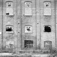 Beet Sugar Factory - Longmont Colorado (Nickie A Photography) Tags: windows abandoned 6x6 film stars colorado factory tmax longmont brokenglass brickwall oldbuilding grafity 120mm yashicad yashikor pushed2 kodak100tmax pushediso400 longmontsugarbeetfactory