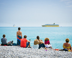 Plage de Nice (miemo) Tags: travel sea summer people france beach boats spring nice europe cotedazur stones watching olympus pebbles shore nizza mediterraneansea omd baiedesanges corsicaferries em5 plagedenice