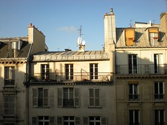 Rooftops (David K. Marti) Tags: city travel blue houses windows roof shadow chimney sky urban house paris france color colour detail building tourism window yellow vertical stone wall architecture floors facade french town colorful europe european day view apartment outdoor top satellite structure architectural upper balconies colored colourful metropolitain dishes yellows antenna structural mansard mygearandme
