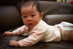 Charlize in a diaper (CeeKay's Pix) Tags: baby brown cute girl look eyes couch charlize koay